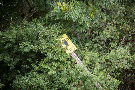 toppled: broken sign of national park in Germany