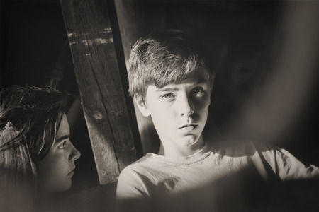 tense: black and white portrait of two teenagers