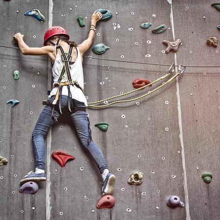 free climbing: teenage girl in a free climbing wall Stock Photo