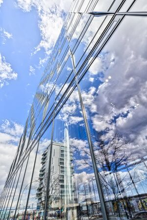 treptow: BERLIN, GERMANY. APRIL 06, 2016:  HDR shot of an office building in Berlin Treptow, with reflections of the sky in the facade.