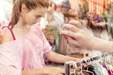 double exposure, teenage girl looking for clothes at a flea market