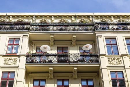 stucco house: balcony of an old house with stucco in Berlin, Kreuzberg