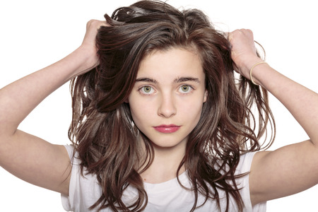 portrait of a teenage girl who is pulling her hair out Stock Photo