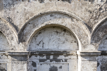 plastered wall: old grungy arch in a wall, for backgrounds