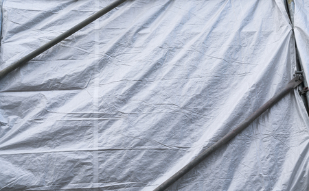gray tarp covering a building for backgrounds