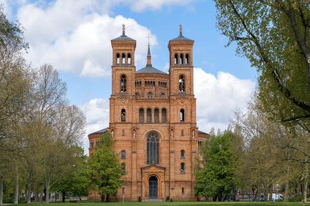 church steeple: red brick church in spring, Berlin Kreuzberg Stock Photo