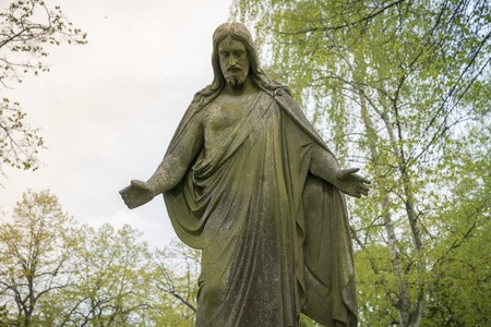 old sculpture of jesus in a park. Unknown artist of the 19th.