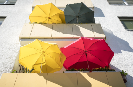 balconies in the summer with colorful parasols