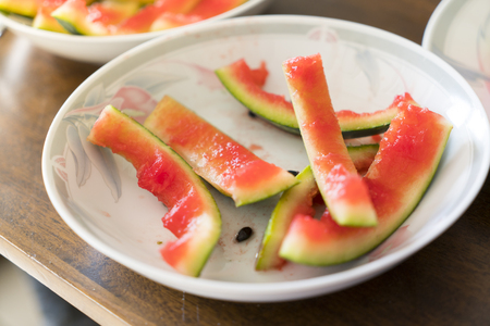 after meal, peel of a watermelon on a plate Banco de Imagens