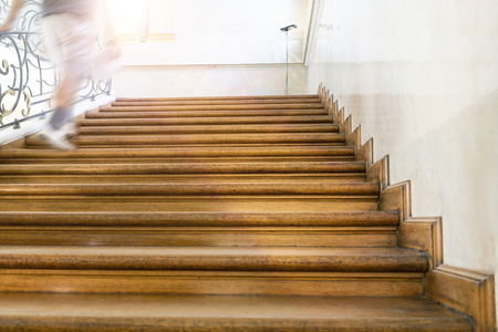 upstairs: motion blur, man goes upstairs, old wooden stairs