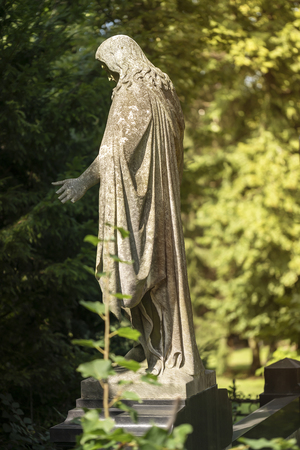 old Jesus sculpture in a park. Unknown artis of the 19th century.