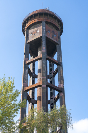 old rusty water tower and clear blue sky Stock Photo