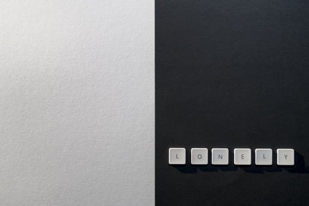 description of the word Lonely on a black and white background Stock Photo