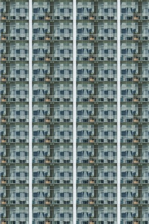 green glass facade pattern of a skyscraper