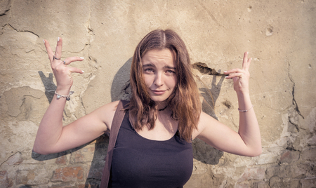 portrait of a young woman gesturing with her hands