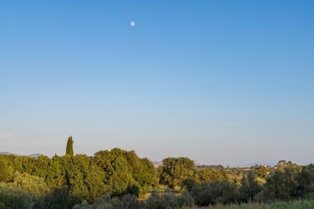 Mediterranean Greek landscape with moon