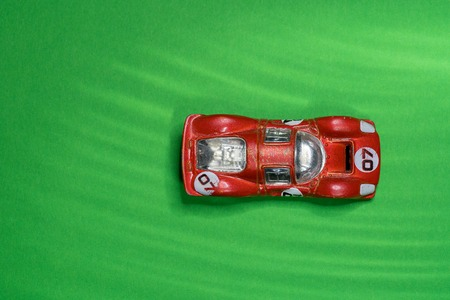 very old and scratched, red, racing, dinky car