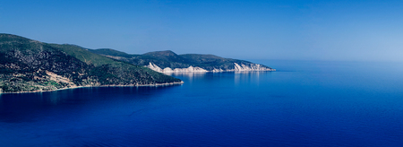 mediterranean panorama landscape, promontory in the deep blue sea