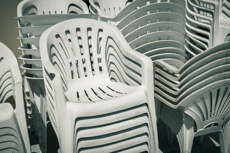 dirty old stacks of plastic chairs Stock Photo