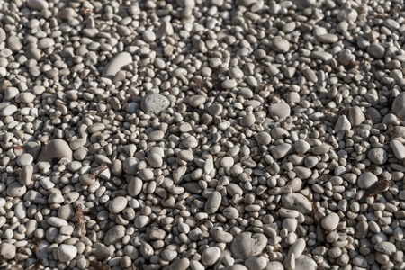 close up of white pebbles on a beach, for backgrounds
