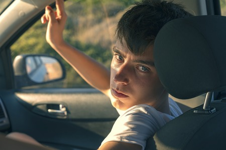 portrait of a young man sitting in a car Stock Photo