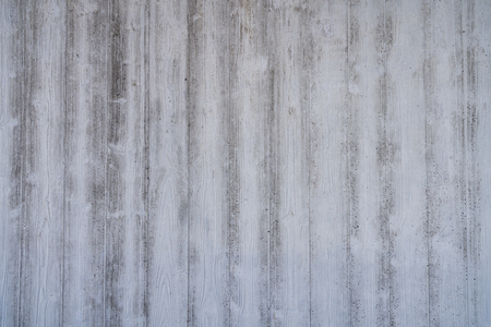 wood grain imprints in a concrete wall for backgrounds Stock Photo