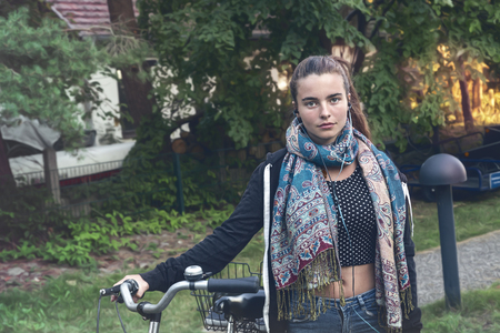 portrait of a young woman with bicycle Imagens