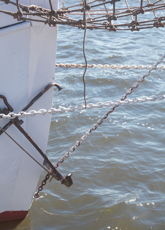 closeup of the prow of a big sailing yacht, with chains and anchor Stock Photo
