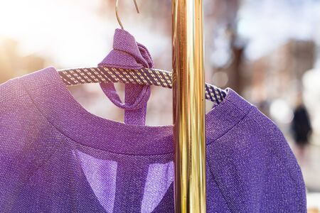 flea market, purple dress hanging on a golden clothes rack Zdjęcie Seryjne