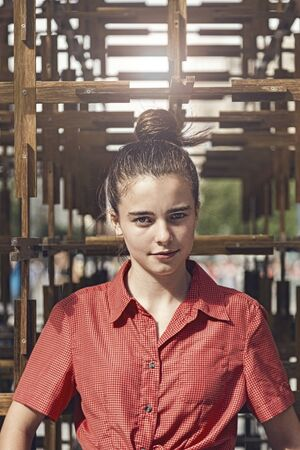 outdoor portrait of a young woman with topknot
