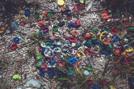 different colored plastic screw caps lying on the floor Stockfoto