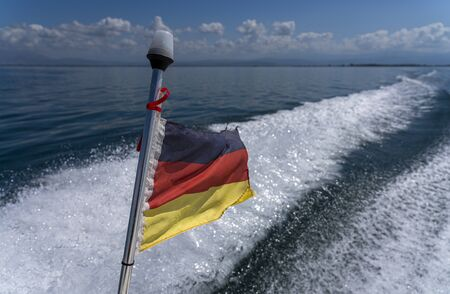 small german flag at the stern of a moving boat Standard-Bild - 130814072