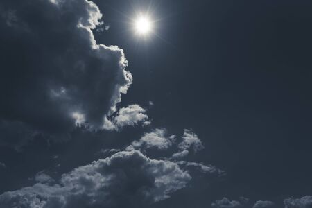 dark sky with cloudscape and sun for backgrounds