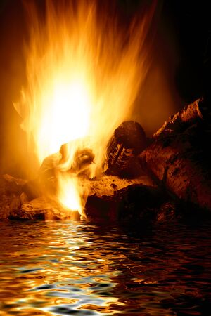 campfire and water in the night for backgrounds and compositions