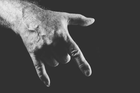 hand showing a cool gesture, in black and white Banco de Imagens