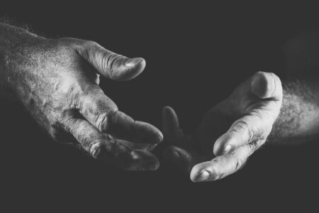 two talking hands, in black and white