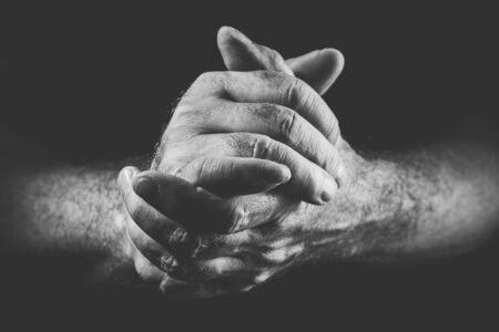 two hands expressing commitment, in black and white