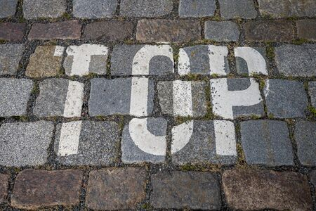 the word top with white color on cobblestone for backgrounds Banco de Imagens