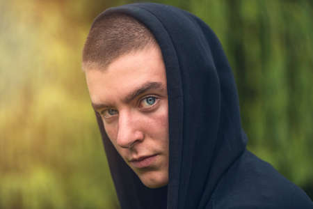 Portrait of a serious young man in a black hoodie Stockfoto