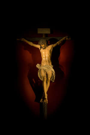 Christ on the cross inside Seville cathedral photo
