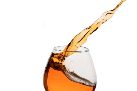 Freeze Action Photography .Splash of Cognac In glass Isolated on White.