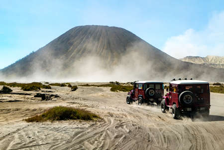 The good moment of those two off-road vehicle drive toward mountain bromo. Which have the beautiful mountains to be in frame with them. Stock Photo