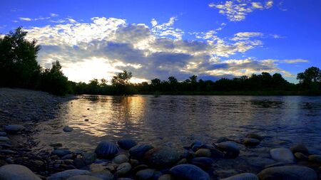 A photo of a sunset on a river in a forest Stockfoto