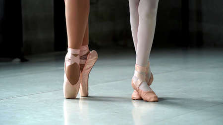 A close up on a ballerina feet during a ballet with focus