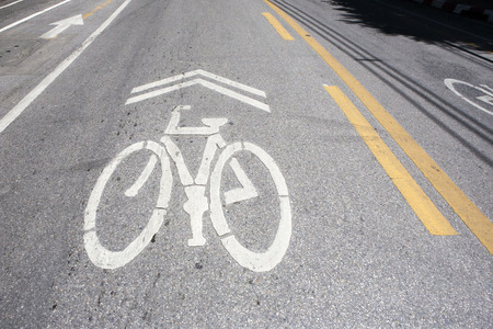 newest: Bicycle symbol on city street