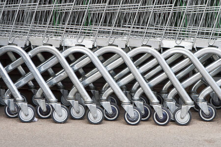 grocery store series: Wheel of Shopping carts on a parking lot   Detail of a shopping cart