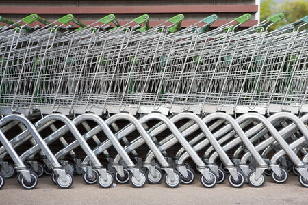 row of shopping trolleys or carts in supermarket photo