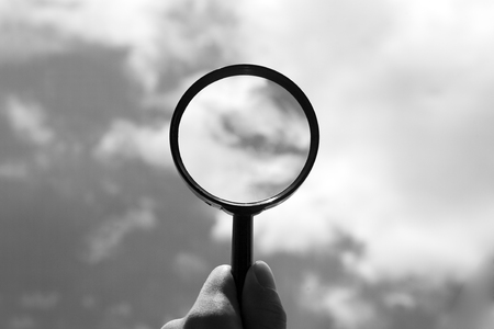 Sky view through magnifying glass in Black   White color