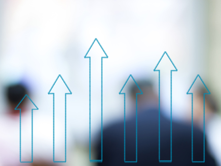 growth bar chart with blurred business people background Stock Photo