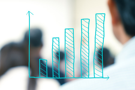 business sign: growth bar chart with blurred business people background Stock Photo